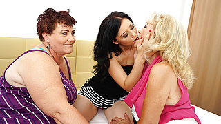 Three horny mature lesbians making out on the bed