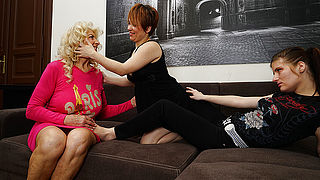 Three horny old and young lesbians make out on the couch