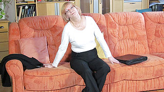Mature German slut masturbating on the couch