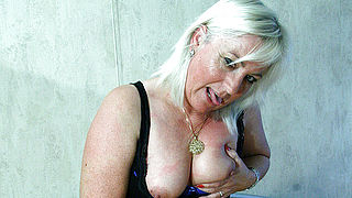 Blonde mama getting her tits filled with cum