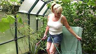 Naked mature feels pussy and ass in greenhouse solo scenes