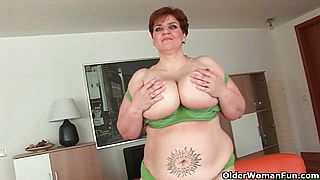 BBW granny gives her big tits and plump pussy a workout