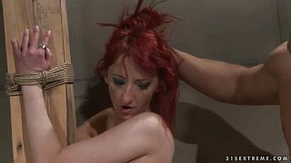 Pretty slender redhead girl Krisztin got tied up to the column by her boyfriend and getting hardly fucked by him