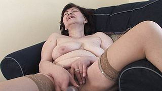 Granny tries dildo in a serious solo display