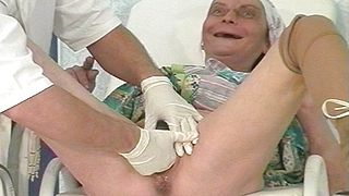 Fisting grannys hairy cunt during full gyno control