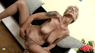 Huge titted blonde granny masturbating