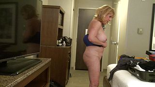 Mature lady gets filmed by her step son when getting dressed