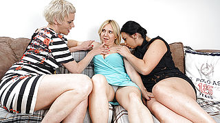 Three horny housewives having fun in bed