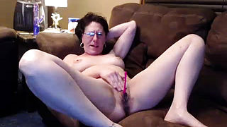 Granny mature masturbate with orange dildo