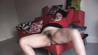 Busty mature lady showing off her big hairy pussy
